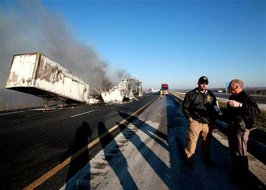Officials work at the scene of a multi-vehicle wreck on Interstate 75 at Paynes Prairie on Sunday, south of Gainesville, Fla. Associated Press Photo: ASSOCIATED PRESS / AP2012