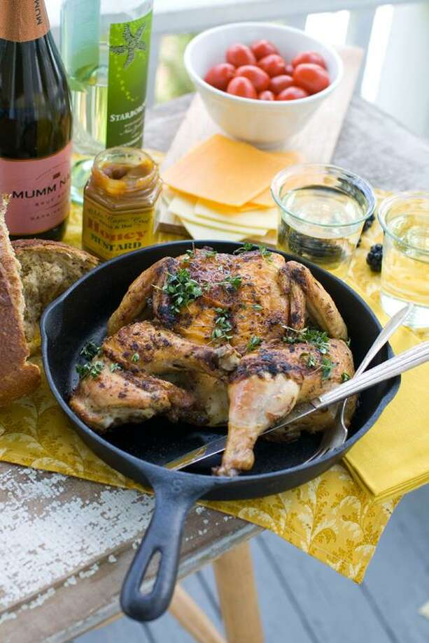 Matthew Mead/Associated Press photo: Cast-Iron Skillet-Roasted Chicken. Photo: AP / FR170582