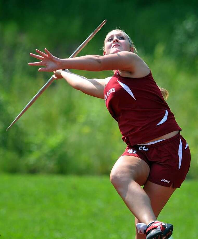 Middletown--North Haven's Onalee Collins on her way to a first place as she throws the javelin during the Class L State Championship meet at Middletown High School.  Peter Casolino/New Haven Register 05/29/12