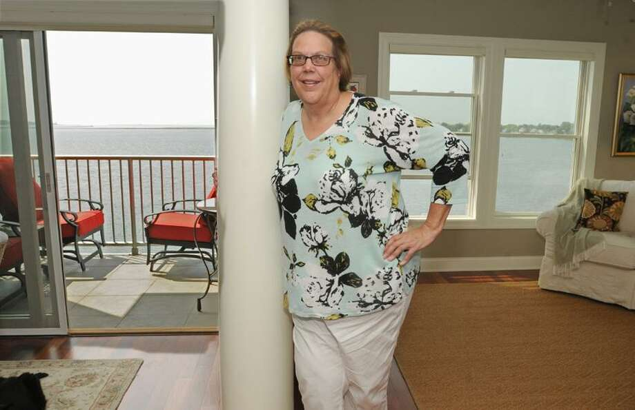 Anne Barker in her home at the Breakwater Bay Condo in New Haven. Her corner condominium has views onto New Haven and the Long Island Sound and the West River. Photo by Peter Hvizdak/ New Haven Register Photo: New Haven Register / ©Peter Hvizdak /  New Haven Register