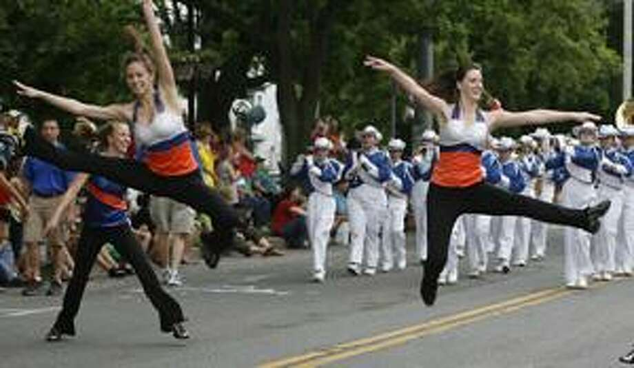 Dispatch Staff Photo by JOHN HAEGEROneida High School color guard members sore through the air as the band marches down Main Street  in the city of Oneida on Friday, May 27, 2011 for the annual Memorial Day parade.