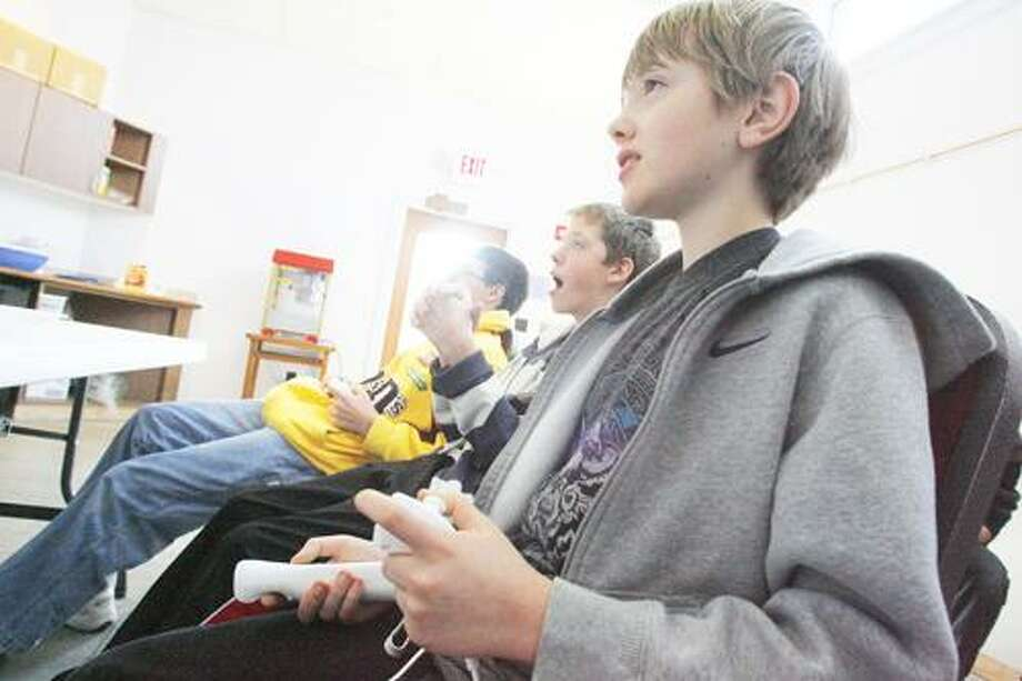 Photo by JOHN HAEGER (Twitter.com/OneidaPhoto) Michael Spring, 12 plays Super Smash Bros. during a tournament at the Morrisville Public Library on Saturday, Jan. 28, 2012, in Morrisville.
