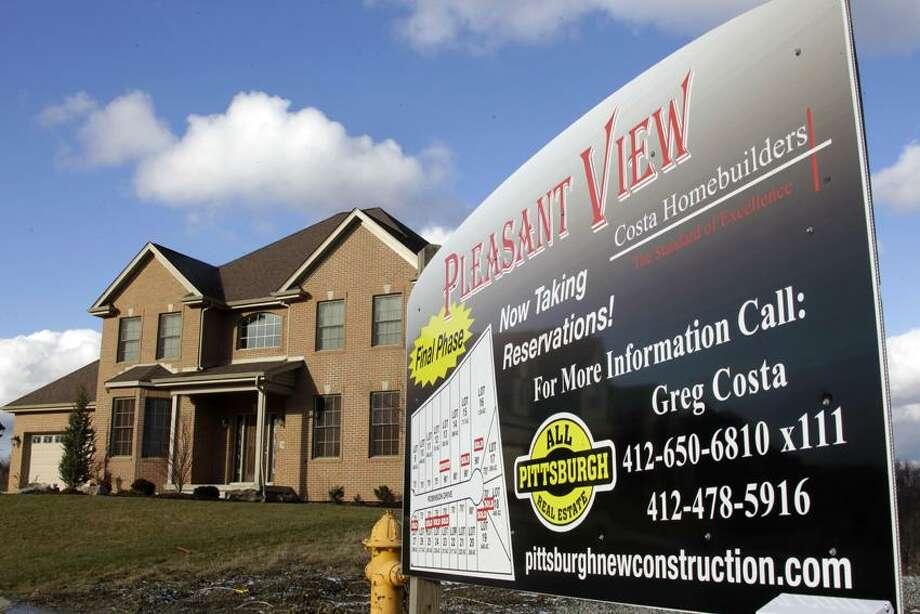 A new home is for sale in a development in Pleasant Hills, Pa. (Associated Press) Photo: AP / AP2012