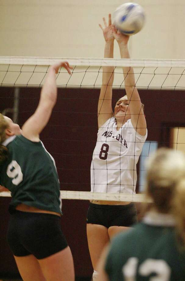 Dispatch Staff Photo by JOHN HAEGER Canastota Stephanie Thornton (8) blocks the shot of Hamilton's Emily Powrie (9) in the first game of the match at Canastota on Friday, Jan. 18, 2011.