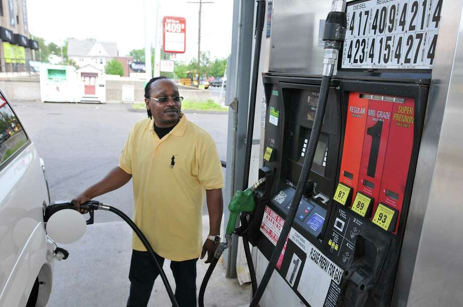 Rodney Williams of New Haven fills up at Best Gas in West Haven. He paid $4.09 for regular unleaded. (Photo by Peter Casolino/New Haven Register)