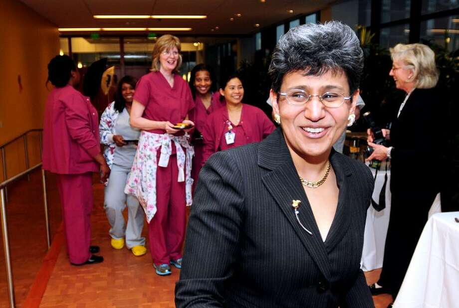 Arnold Gold/Register photo: Dr. Anees Chagpar, front, director of the Breast Center at Smilow Cancer Center at Yale-New Haven Hospital, enters a reception celebrating the center's accreditation by the National Accreditation Program for Breast Centers. Joining her are nurses and surgical techs from Smilow.