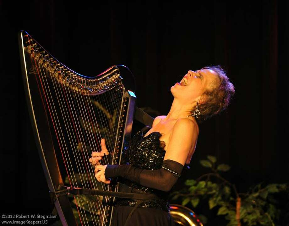 &Copy; Robert Stegmaier photo: Hip-harpist Deborah Henson-Conant, sans her trademark dreadlocks, says the instrument gives her a rich combination of the physical and musical. / R-W-STEGMAIER