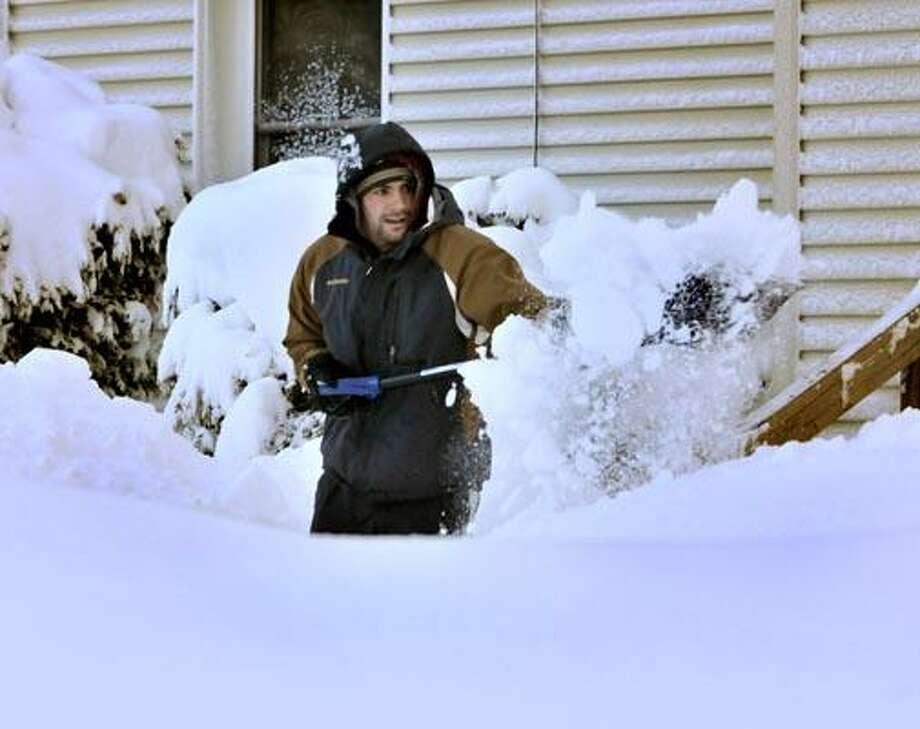 Dominic Amaturo shovels his walk on Fairfield Street in New Haven Thursday. (Melanie Stengel/Register)