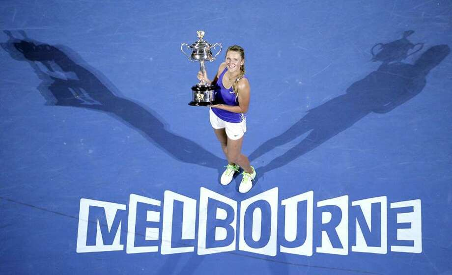 Victoria Azarenka of Belarus holds her trophy after defeating Russia's Maria Sharapova in the women's singles final at the Australian Open tennis championship in Melbourne, Australia, Saturday, Jan. 28, 2012. (AP Photo/John Donegan) Photo: AP / AP2012