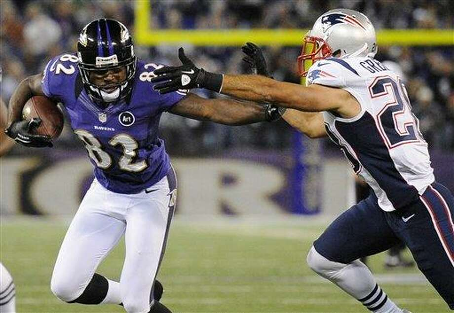 Baltimore Ravens wide receiver Torrey Smith, center, rushes between New England Patriots defenders Dont'a Hightower (54) and Steve Gregory in the second half of an NFL football game in Baltimore, Sunday, Sept. 23, 2012. (AP Photo/Nick Wass) Photo: ASSOCIATED PRESS / AP2012
