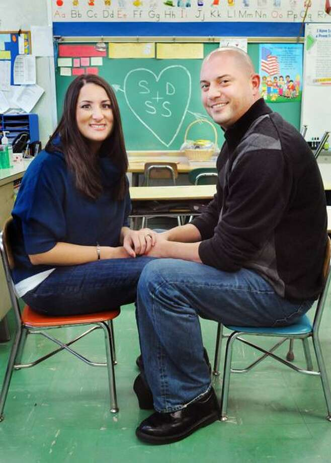 Samantha Sampiere, left, and Steven Dobson  have their engagement  photos taken at Bradley School in Derby where they first attended classes together.  Melanie Stengel/Register