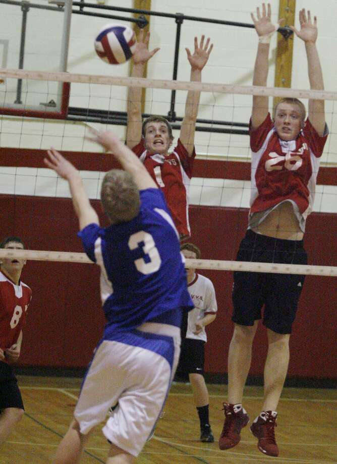 Dispatch Staff Photo by JOHN HAEGER Oneida's Shawn Ano (3) hits the ball over the net as VVS's Steve Geer (1) and Jordan Loboda (26) defend in the second game of the match on Thursday, Jan. 27, 2011 at VVS.