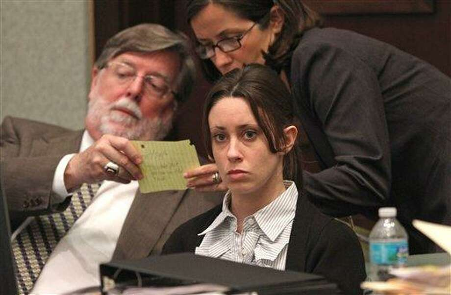 Casey Anthony, center, sits at the defense table with her attorneys Cheney Mason, left, and Lisabeth Fryer at the Orange County Courthouse in Orlando, Fla., Wednesday, May 25, 2011. Anthony is charged with first-degree murder in the death of her daughter, Caylee. If convicted she could face the death penalty. (AP Photo/Red Huber, Pool) Photo: AP / POOL ORLANDO SENTINEL