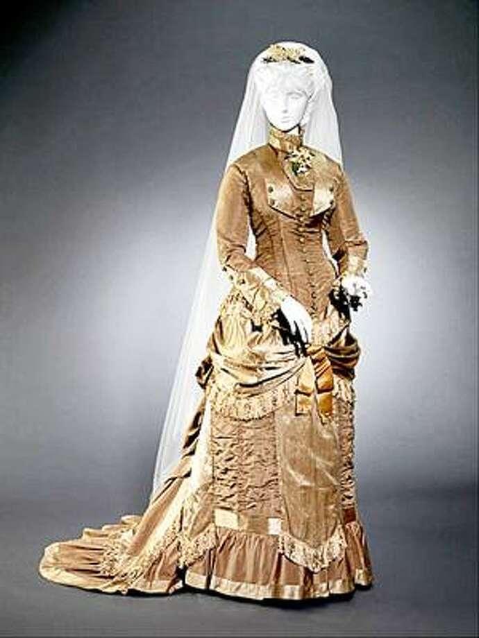 "Photo Courtesy <a href=""http://www.mwpai.org"">www.mwpai.org</a> Ellen Curtis, Wedding Dress: Bodice and Skirt, 1879"