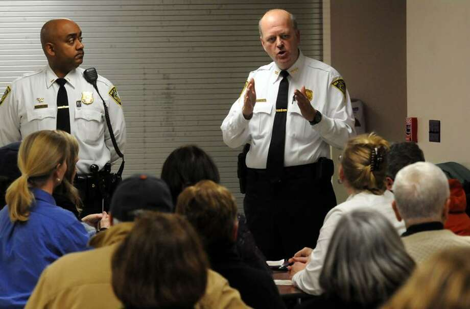 Worthington Hooker School in New Haven was the site for an East Rock community meeting with Police Lt. Thad Reddish left and New Haven Police Chief Dean Esserman. Photo by Mara Lavitt/New Haven Register1/23/12
