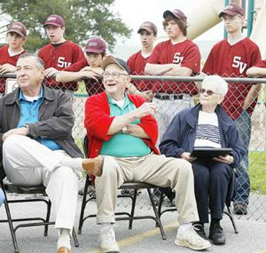 Dispatch Staff Photo by JOHN HAEGER Glenn Stevens, center in red, watches the cemerony to name the Glenn Stevens Athletic Complex on Saturday, May 21, 2011 at Stockbridge Valley Central School.