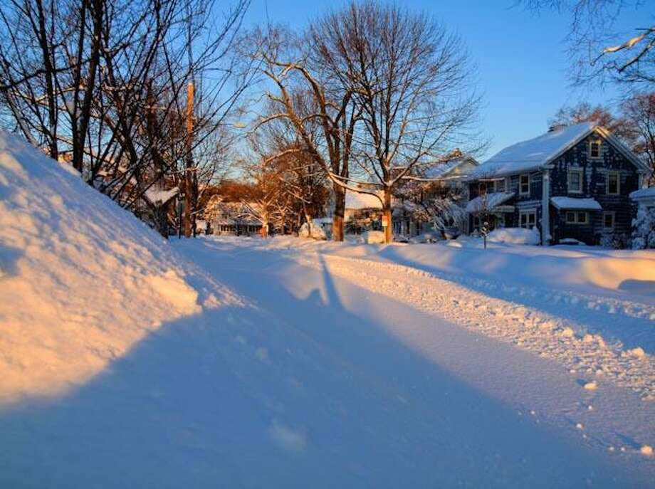 """Gary F. Spinner sent this photo of Elmwood Road in New Haven, which he reports """"did not see a plow until lunch time today, and only one pass down the middle of the road at that.""""  He said he took the photo while shoveling snow early this morning, in hopes of getting out the driveway to go to work.  """"Never happened,"""" he said.    Gary / Copyright  © 2011 Gary F. Spinner"""