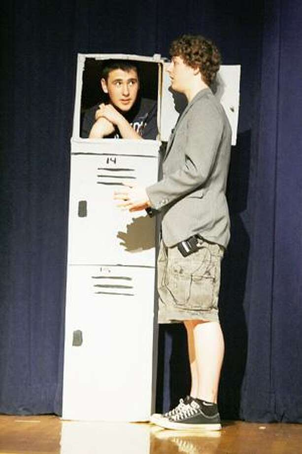 "Dispatch Staff Photo by JOHN HAEGER Alex Galler (in locker) and Nathan Mitchell rehearse a scene from ""Get Smart"" on Wednesday, May 25, 2011 at Madison Central School."