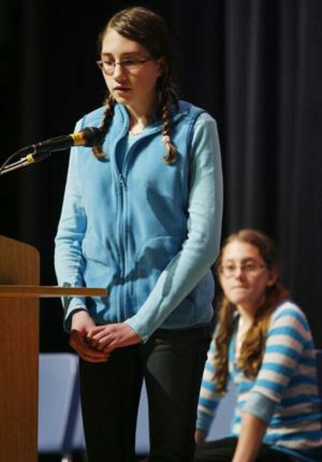 """Photo by JOHN HAEGER Otto Shortell Middle School seventh grader Melanie Rose, 12, spells """"alphabetical"""" to win the annual Oneida City School District Spelling Bee on Wednesday, Jan. 26, 2011, as Seneca Street Elementary School sixth grader Lauren Smith, 11, looks on. Smith placed second in the event."""