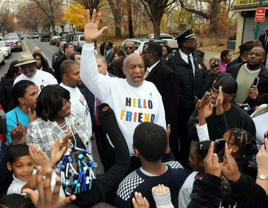 Comedian and educator Bill Cosby right toured several blocks of the Newhallville section of New Haven in november, meeting and greeting residents. Here he asks Lincoln Bassett Community School students to pledge to encourage their parents to become involved. Photo by Mara Lavitt/New Haven Register