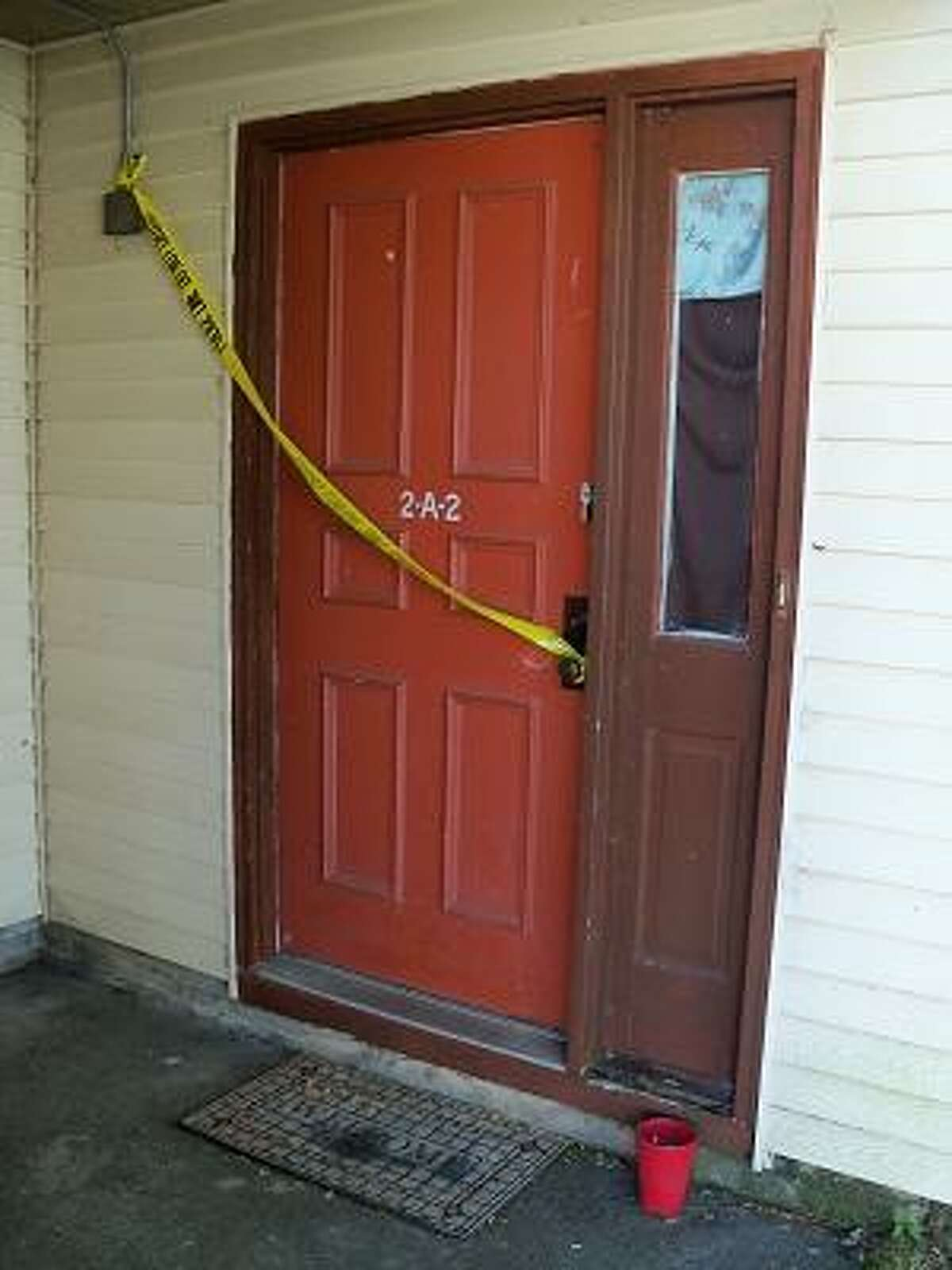 Police tape blocks off the door of an apparent shooting in Canton. Photo by Scot Allyn/Register Citizen Staff
