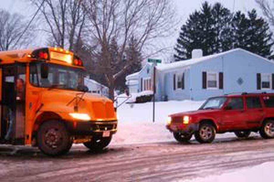 Dispatch Staff Photo by MATT POWERS A VVS school bus and a Jeep sit on School Street in Sherrill Tuesday after they collided.