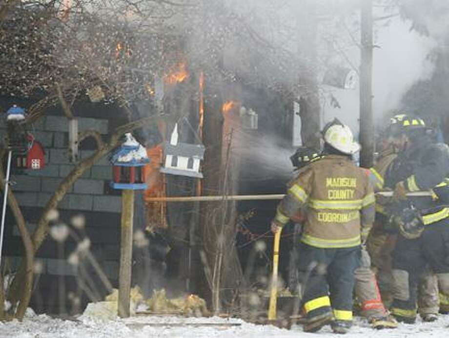 Dispatch Staff Photo by JOHN HAEGERFire crews from Wampsville, Oneida, Canastota, Lincoln and Durhamville battle a house fire on Canal Road near the intersection of North Court on Tuesday, Dec. 21, 2010.
