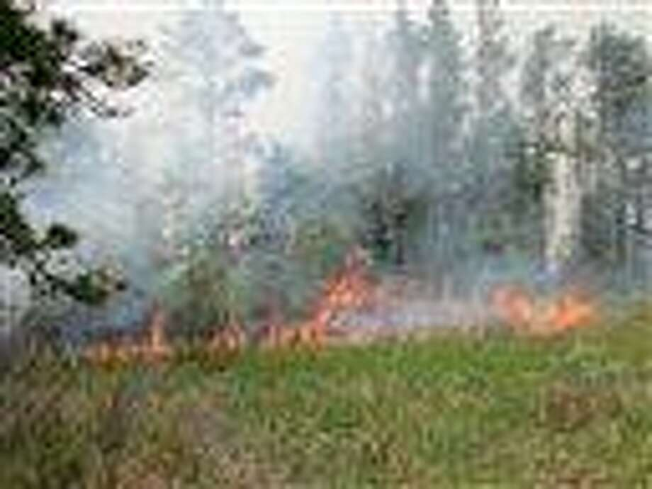 In this photo released by the U.S. Fish and Wildlife Service, the Pine Creek North wildfire is shown at Seney National Wildlife Refuge in Seney, Mich. Wednesday, May 23, 2012. The wildfire in Michigan's Upper Peninsula has burned at least 17,000 acres or more than 26 square miles. Associated Press Photo: AP / U.S. Fish and Wildlife Service