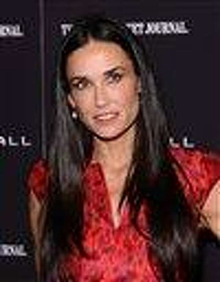 "In this October 2011 file photo, actress Demi Moore attends the premiere of ""Margin Call"" in New York. A spokeswoman for Moore said Tuesday the actress is seeking professional help to treat her exhaustion and improve her health.  Associated Press Photo: AP / AP2011"