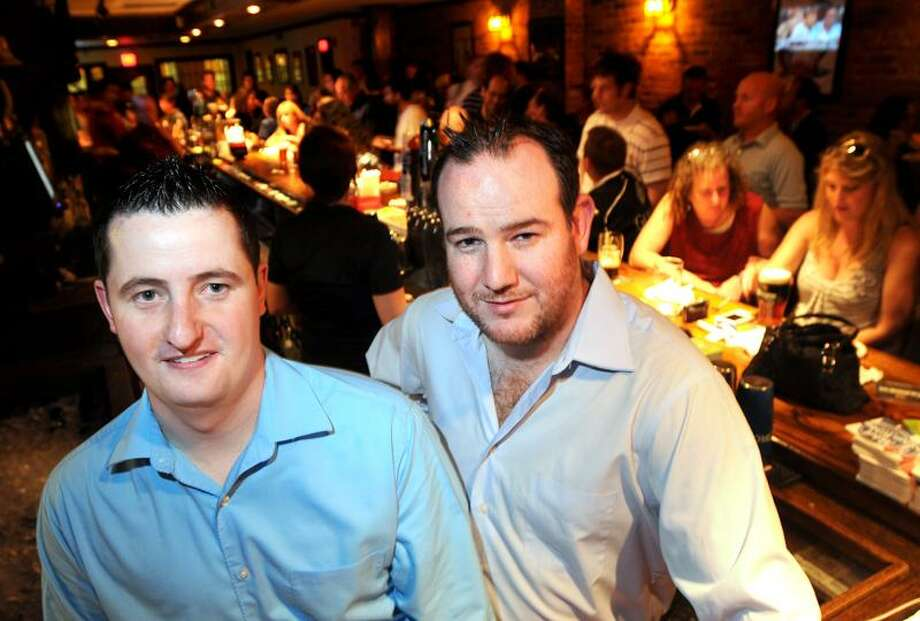 Colin O'Toole, left, and Damian Cashman, owners of O'Toole's Irish Pub & Restaurant in New Haven, are opening for business today. Arnold Gold/Register
