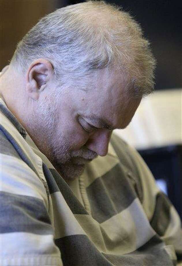 In this Dec. 1, 2011 file photo, Richard Beasley, 52, appears in Summit County Common Pleas Court in Akron, Ohio, on drug charges. Confusion over rules governing prisoner transfers and lack of communication helps explain why Beasley, now suspected in a deadly Craigslist robbery scheme, was mistakenly released from Ohio custody twice, according to a state prisons report. Associated Press Photo: AP / 2011 AP