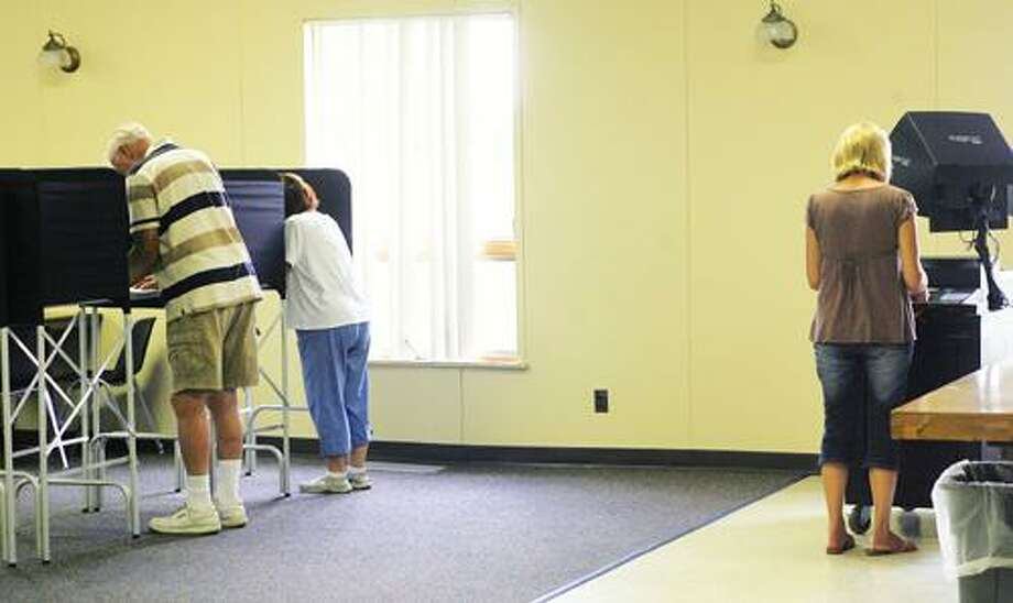 Photo by JOHN HAEGER (Twitter.com/OneidaPhoto) Voters in the town of Verona cast their ballot in the primaries on Tuesday, Sept. 13, 2011 at the Verona Fire Department.