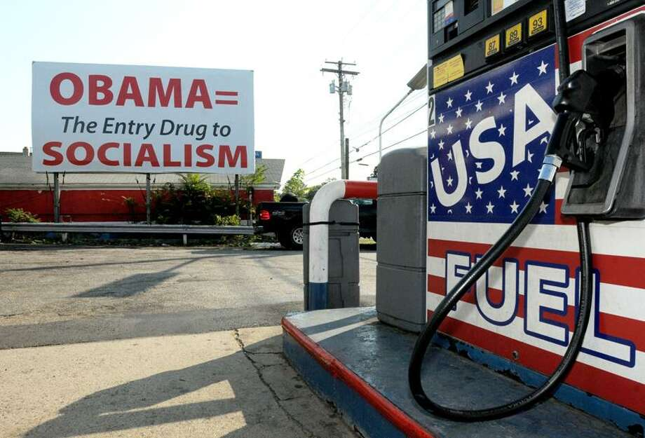 Gas Station owner Fayez Ghaley (not in photo) at USA Fuel at 520 Boston Post Road in Milford claims an anti-Obama sign has hurt business.  Peter Hvizdak / New Haven Register Photo: New Haven Register / ©Peter Hvizdak /  New Haven Register