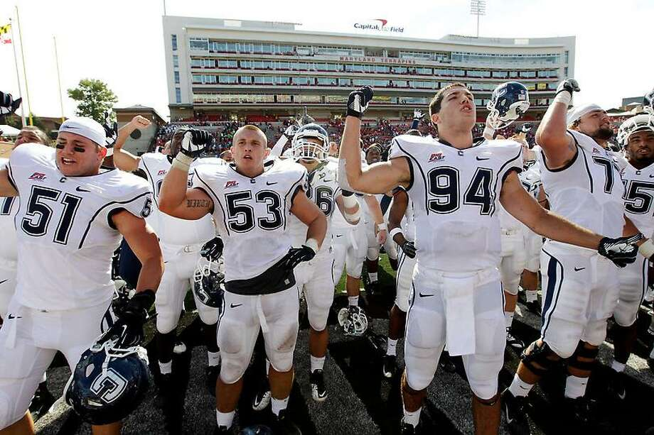 Members of the Connecticut football team acknowledge fans in the stands after an NCAA college football game against Maryland in College Park, Md., Saturday, Sept. 15, 2012. Connecticut won 24-21. (AP Photo/Patrick Semansky) Photo: AP / AP
