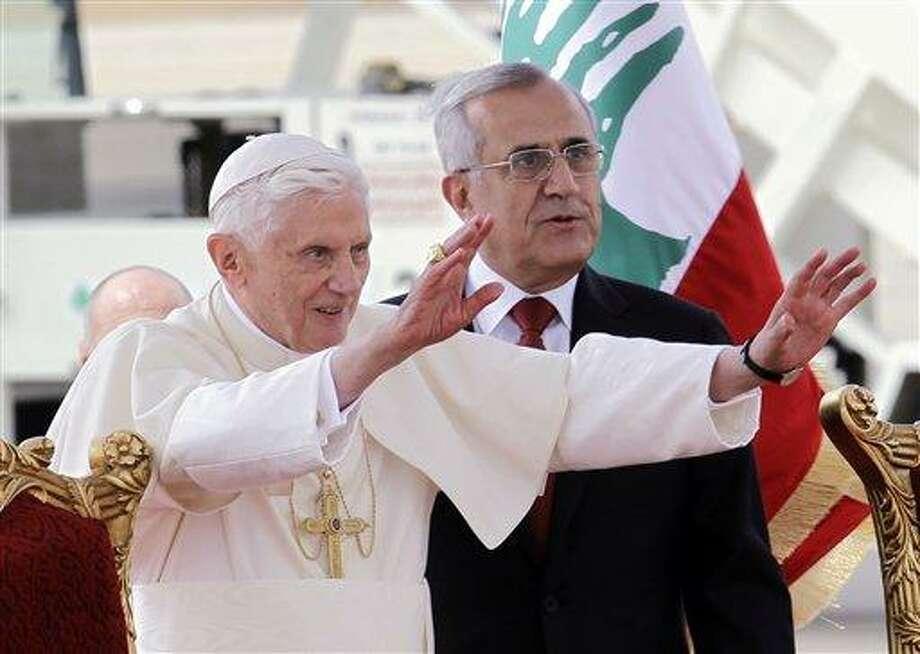 Pope Benedict XVI stands next to Lebanese President Michel Suleiman as he waves to the crowd Friday at Rafik Hariri international airport, in Beirut, Lebanon. Associated Press Photo: AP / AP