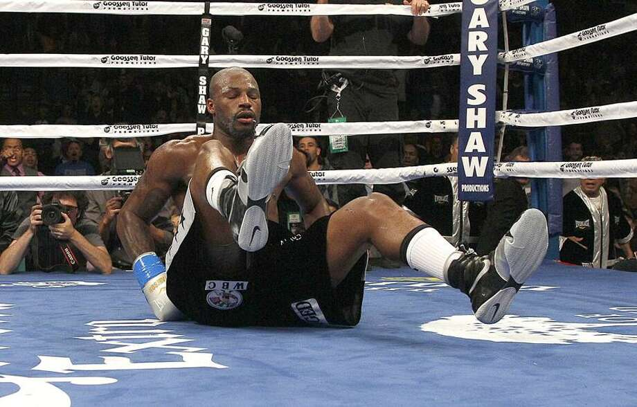 Chad Dawson after being knocked down by Andre Ward during a WBA/WBC super middleweight championship boxing match in Oakland, Calif., Sept. 8, 2012. (AP Photo/Jeff Chiu) Photo: AP / AP2012