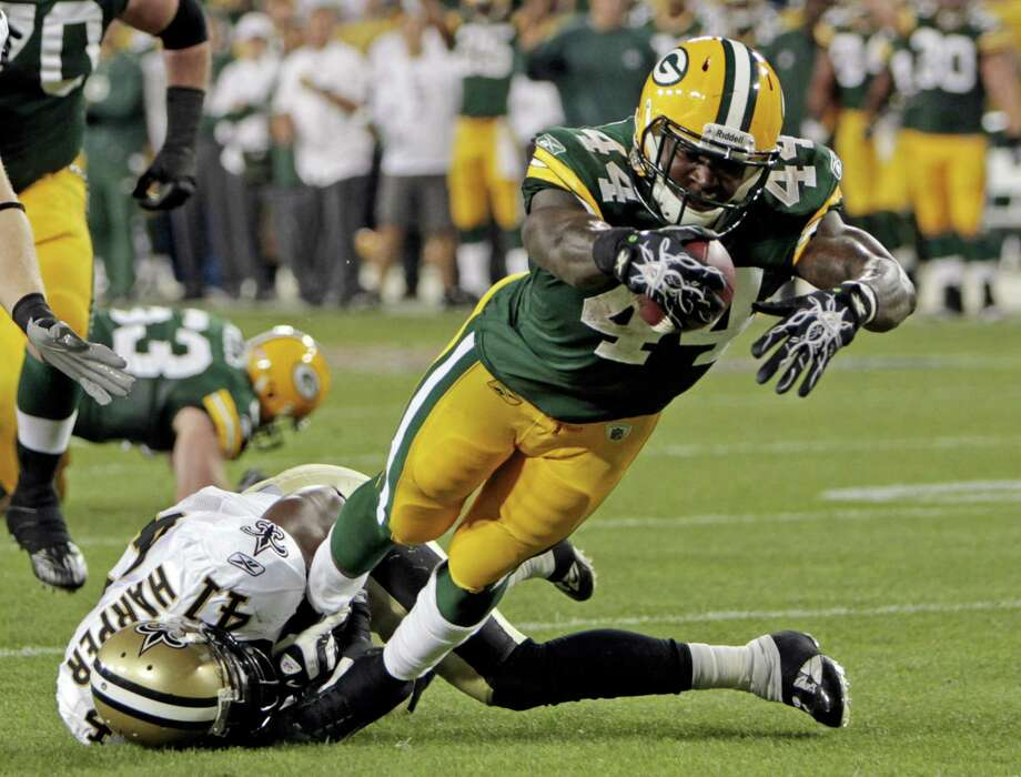 New Orleans Saints' Roman Harper (41) can't stop Green Bay Packers' James Starks (44) from diving into the end zone for a touchdown run during the first half of an NFL football game Thursday, Sept. 8, 2011, in Green Bay, Wis. (AP Photo/Mike Roemer) Photo: ASSOCIATED PRESS / AP2011