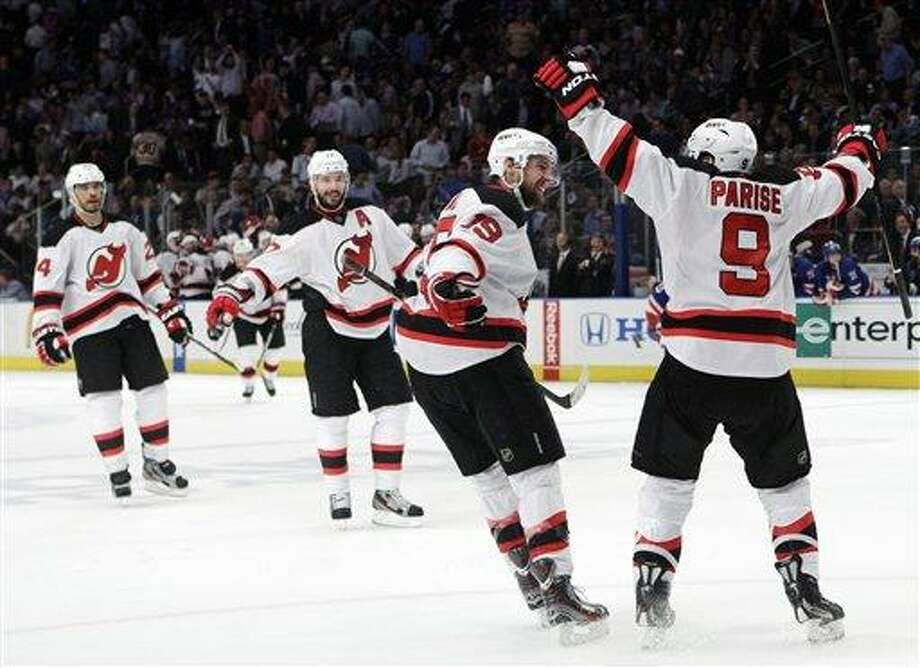 New Jersey Devils' Zach Parise, right, celebrates with teammates, from left, Bryce Salvador, Ilya Kovalchuk, of Russia, and Travis Zajac after scoring against the New York Rangers during the third period of Game 5 of an NHL hockey Stanley Cup Eastern Conference final playoff series, Wednesday, May 23, 2012, in New York. The Devils won 5-3. (AP Photo/Frank Franklin II) Photo: AP / AP