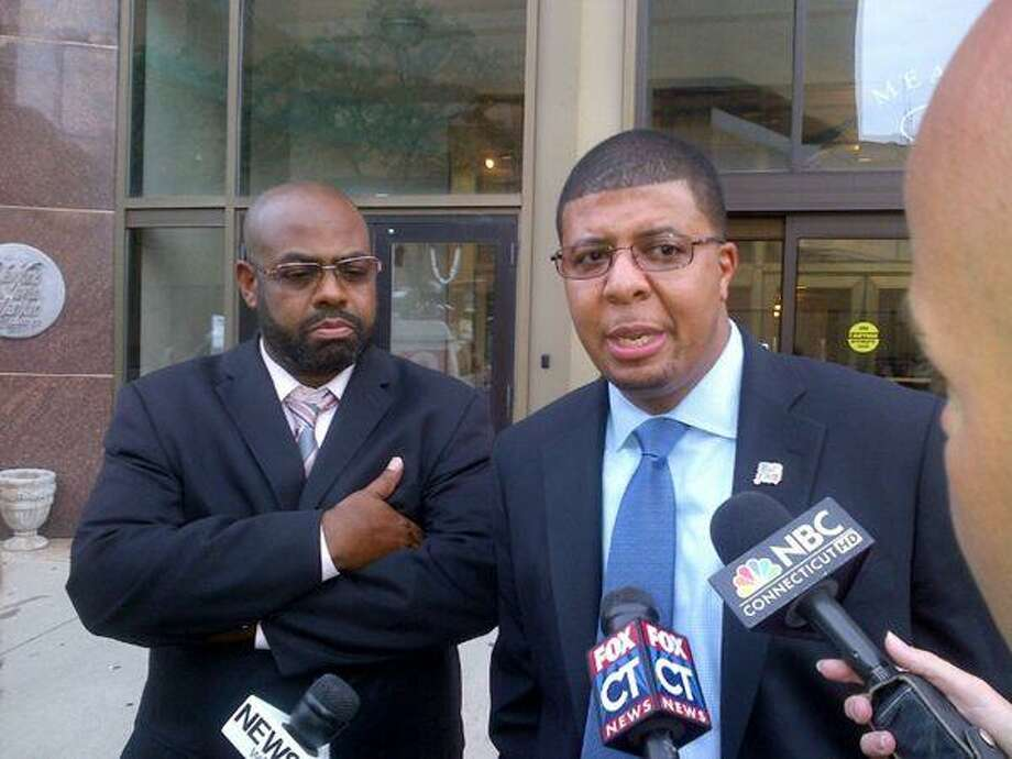 Hillhouse Principal Kermit Carolina and his attorney Michael Jefferson speak following a meeting with New Haven Superintendent of Schools Reginald Mayo and others  Photo by Shahid Abdul-Karim