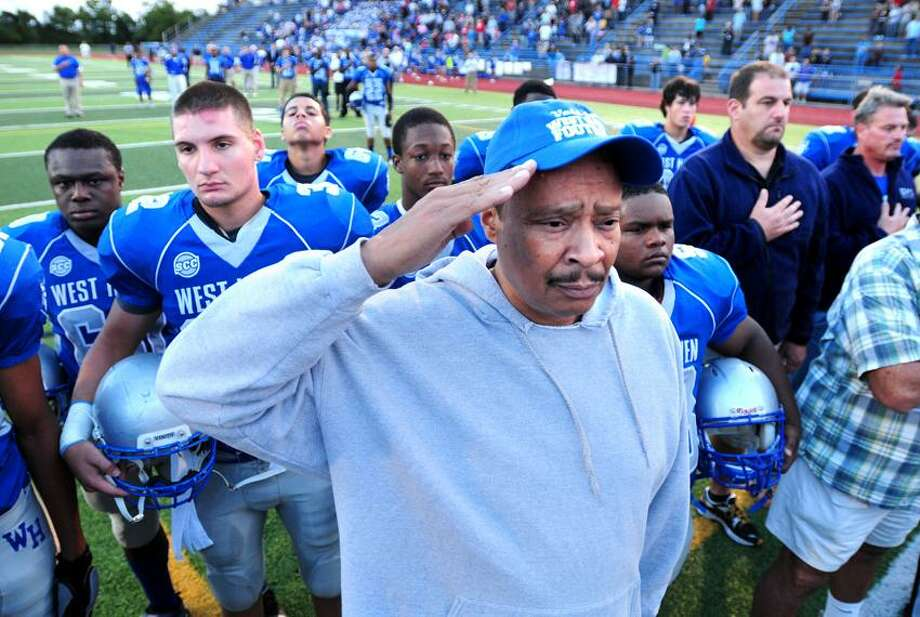 The West Haven team lines up behind Vietnam era veteran James Lash (center) and other veterans during the National Anthem before their game against Hamden in West Haven on 9/14/2012.Photo by Arnold Gold/New Haven Register   AG0462C