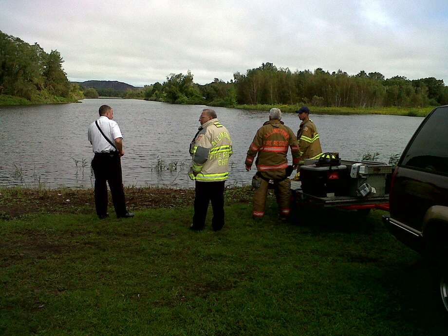 The scene at the West River today, where crews were searcing after a man reportedly jumped in.  Photo by William Kaempffer