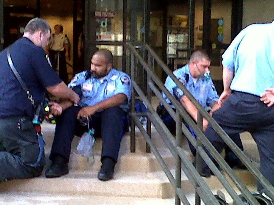 Judicial marshals sit outside the courthouse after a CO scare at 235 Church St.  Photo by William Kaempffer