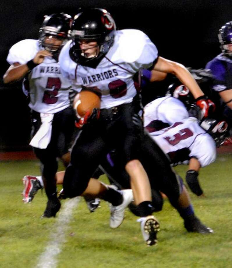 Valley Regional's Evan Smith runs for a first down in 3rd-quarter action of North Branford's win Friday.   Melanie Stengel/Register