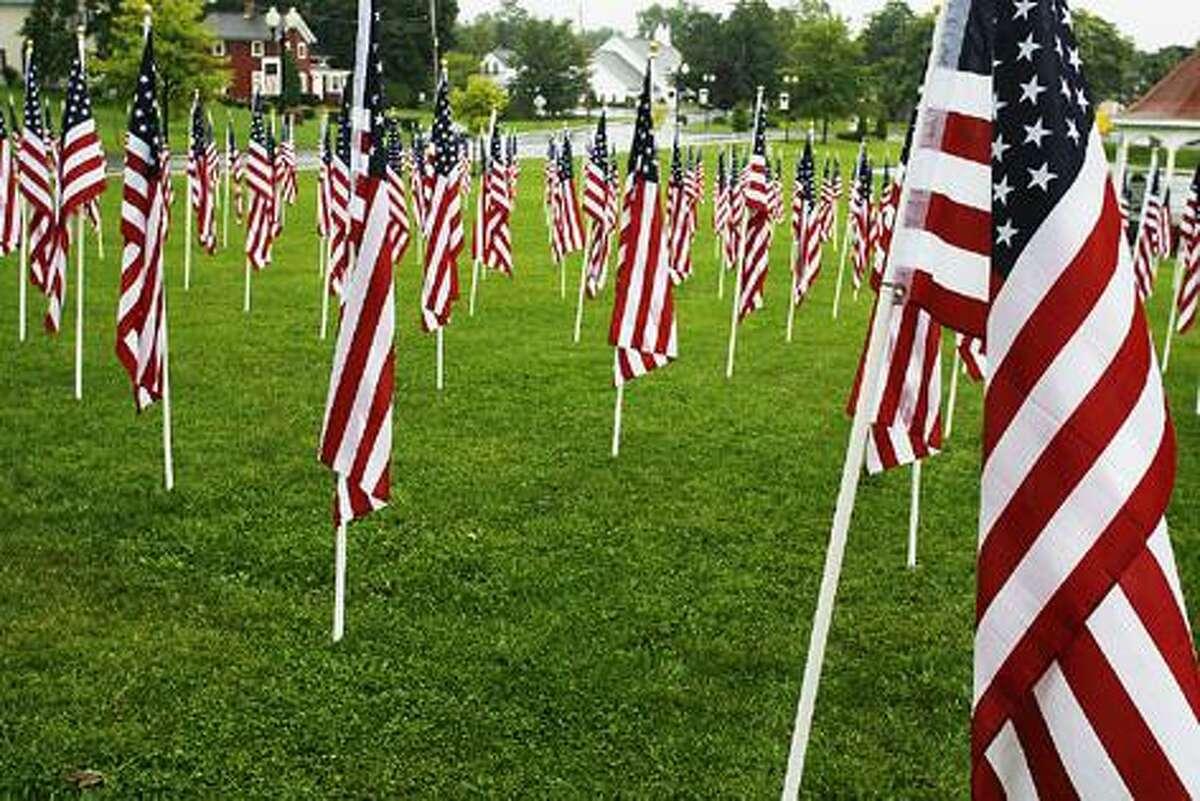 Photo by JOHN HAEGER (Twitter.com/OneidaPhoto) Flags fill the park in Sherrill on Wednesday, Sept. 7, 2011.