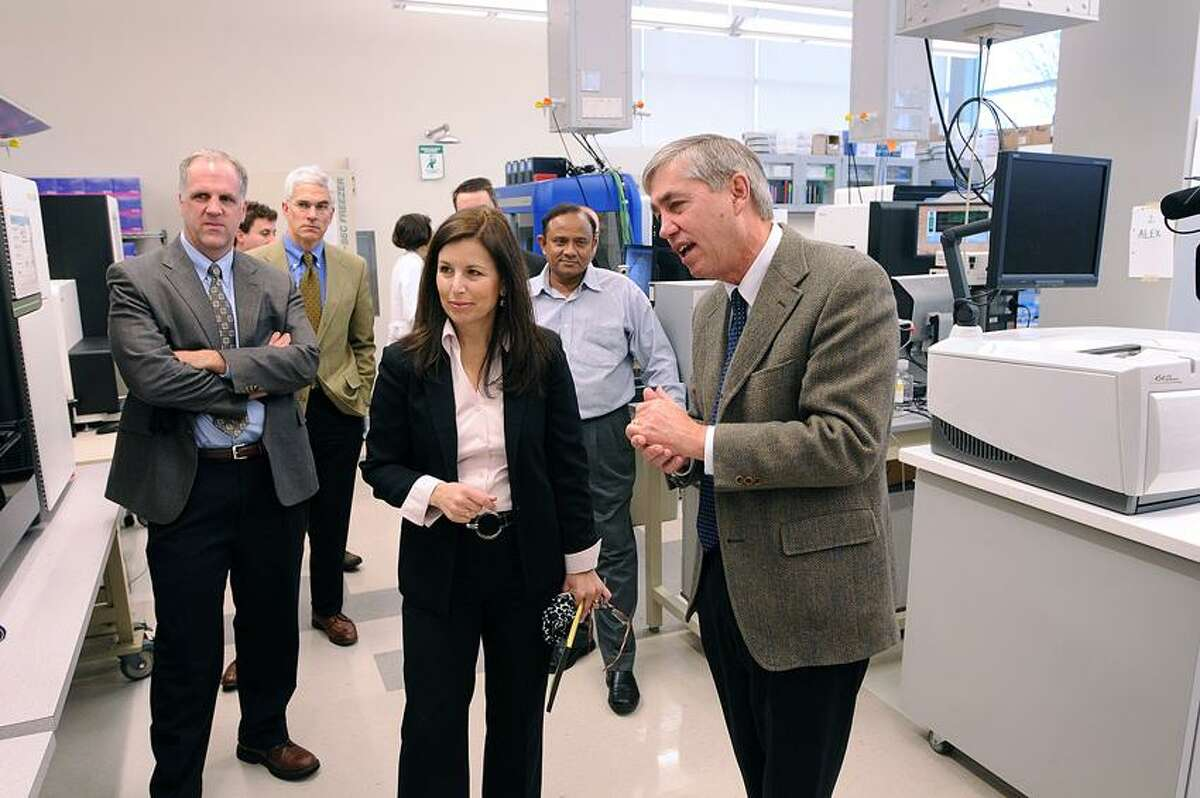 State Sen. Gayle S. Slossberg, D-Milford, gets a tour of one of the genetics labs by Dr. Rick Lifton, right, executive director at the Yale Center for Genome Analysis, and Scott Strobel, left, vice president of West Campus Planning and Development, as she toured the Yale's West Campus facilities. Peter Casolino/Register