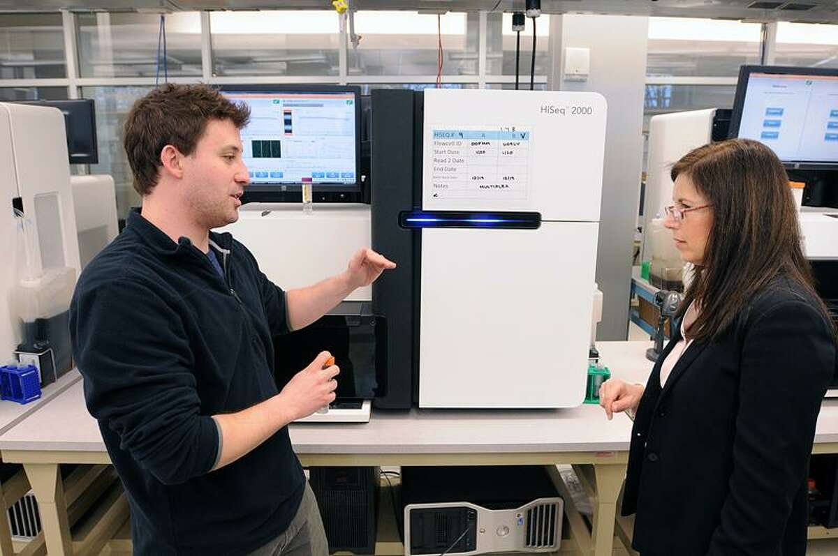 John Overton, associate director of sequencing, explains the workings of a gene sequencer to state Sen. Gayle S. Slossberg, D-Milford, at the Yale Center for Genome Analysis as she toured the Yale's West Campus facilities. Peter Casolino/Register