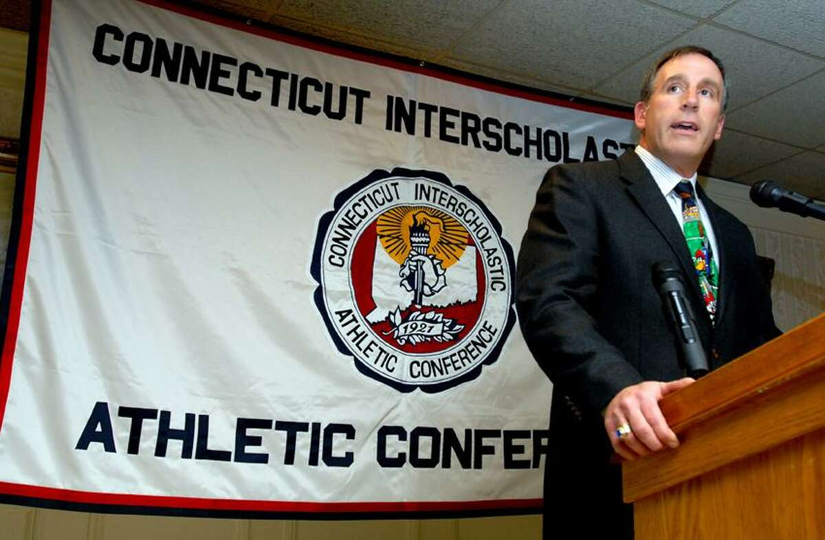 Cheshire coach Mark Ecke speaks at the CIAC football luncheon at the Aqua Turf Club in Southington on 12/2/2009.Photo by Arnold Gold AG0343B