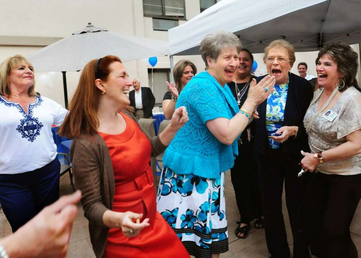 From left, Susan Gianelli, Mary Fusco, Josephine Amarra, Joann Voulo, and Janet Shahen dance to