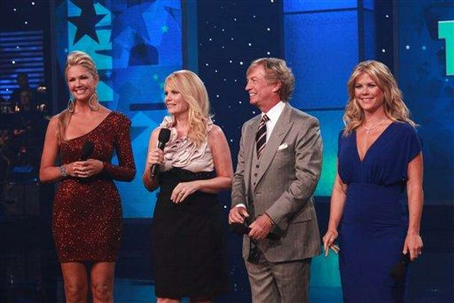 This photo provided by Muscular Dystrophy Association, The 46th annual Muscular Dystrophy Association telethon co-hosts,  from left to right, Nancy O'Dell, Jann Carl, Nigel Lythgoe and Alison Sweeney ad-lib personal salutes to Jerry Lewis, Sunday, Sept. 4, 2011, in Las Vegas. The hosts of the telethon say Jerry Lewis has retired from the yearly fundraiser, the organization's first comments since announcing the beloved icon's departure last month. (AP Photo/MDA, Richard Cartwright) Photo: AP / Muscular Dystrophy Association
