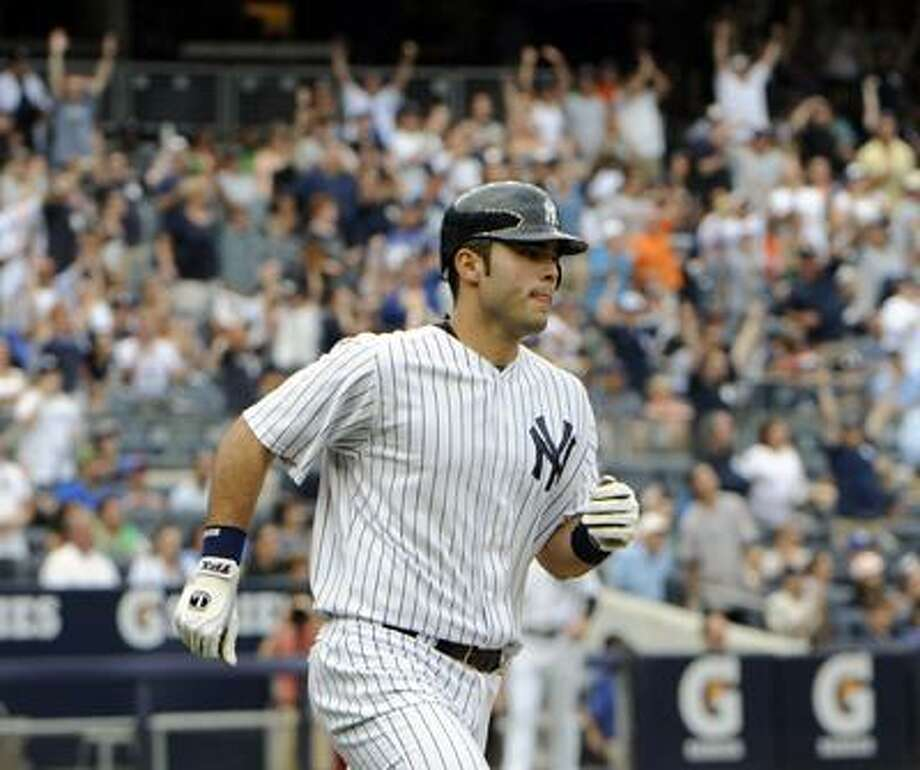 New York Yankees' Jesus Montero rounds the bases after hitting a two-run home run during the seventh inning of a baseball game against the Baltimore Orioles, Monday, Sept. 5, 2011, at Yankee Stadium in New York. The Yankees defeated the Orioles 11-10. (AP Photo/Bill Kostroun) Photo: AP / FR51951 AP
